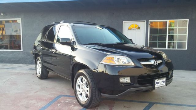 2006 Acura MDX Touring Wow This Acura MDX Touring is a gem All-wheel Drive Super clean Black on