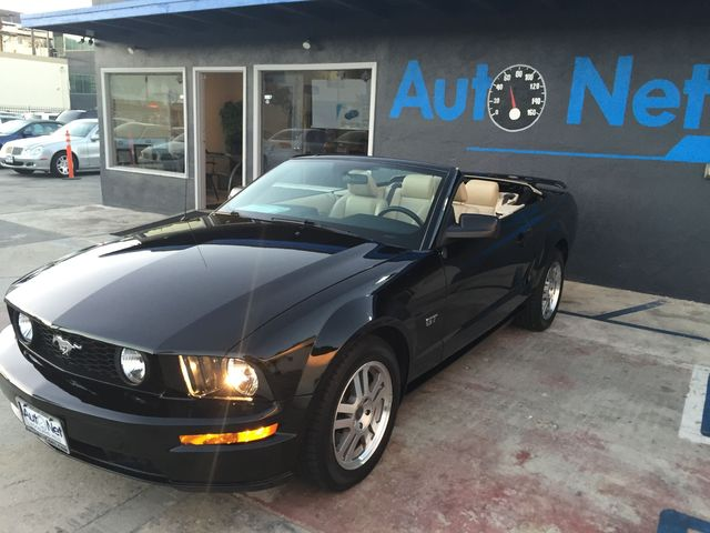 2005 Ford Mustang GT Convertible Check out this Ford Mustang GT This convertible is Black on Tan