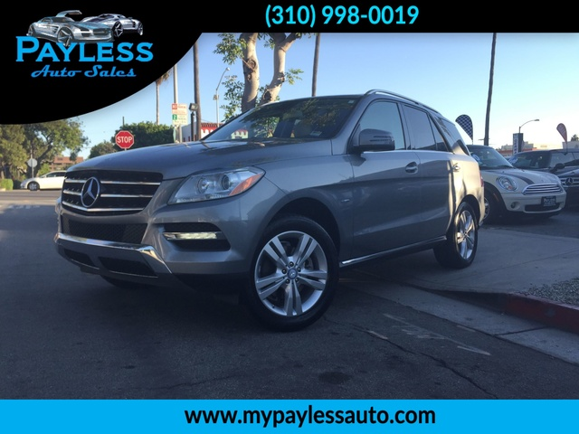 2012 Mercedes M-Class ML350 OUR 2012 MERCEDES BENZ ML 350 HAS GRAY EXT WITH BEIGE INT IT HAS ONL