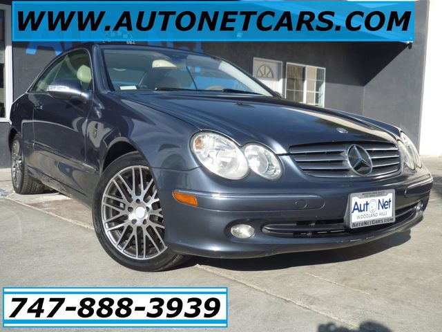 2005 Mercedes CLK320 32L This 2005 Mercedes-Benz CLK 320 is coupe with Cadet Blue metallic on Bei