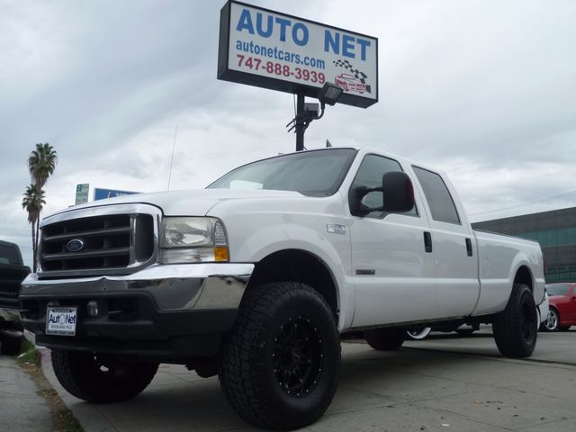 2004 Ford Super Duty F-250 XL TURBO DIESEL LB This 2004 Ford F-250 XLT Supercab is LIFTED 4X4 with