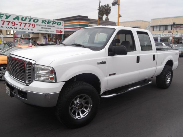 2006 Ford Super Duty F-250 XLT we sell the repos for the banks which means the banks loss is your
