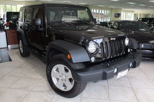 2015 Jeep Wrangler Unlimited Sport CARFAX CERTIFIED ONE OWNER FACTORY WARRANTY 4X4 LOW MIL
