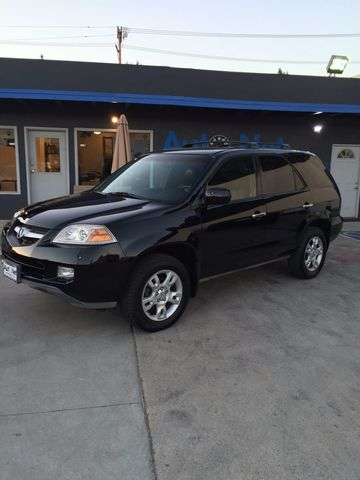 2006 Acura MDX Touring w 3rd Row seats am One look at this car will have you say WOW This Acura