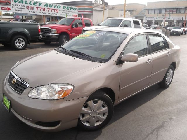 2005 Toyota Corolla LE we sell the repos for the banks which means the banks loss is your GAIN and